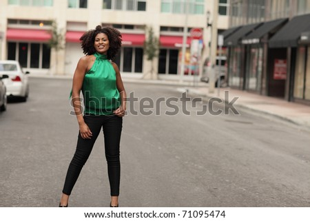Attractive woman in the middle of the city street - stock photo