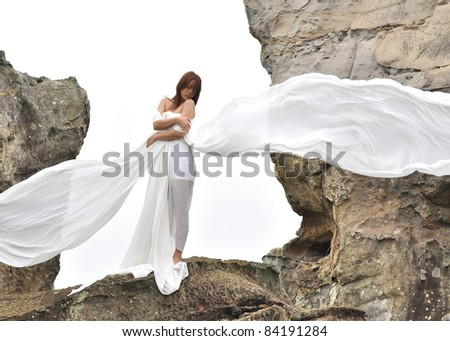 attractive woman in white dress looks like angel - stock photo