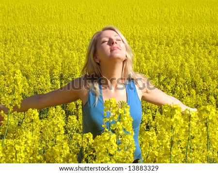 Attractive woman in yellow - stock photo