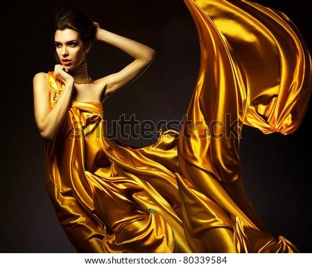 attractive woman in yellow fabric - stock photo