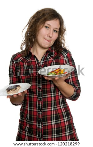 attractive woman is choosing between cake and salad over white - stock photo