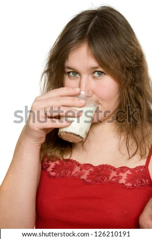 attractive woman is drinking diary product over white
