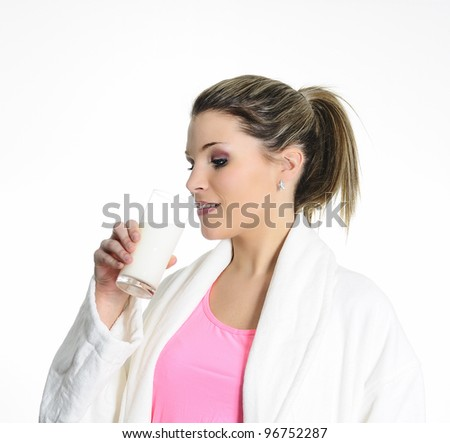 attractive woman is drinking fresh milk - stock photo