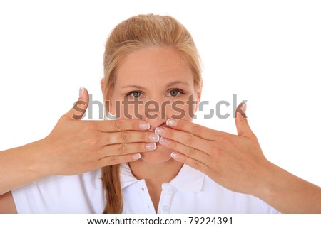 Attractive woman keeps her mouth shut. All on white background.