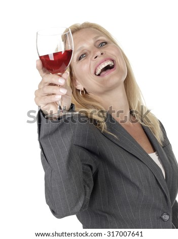 Attractive woman laughing and holding glass of red wine. - stock photo