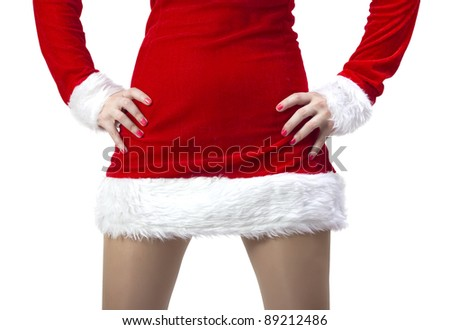 Attractive woman legs in Santa Claus costume - stock photo