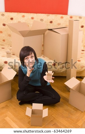 Attractive woman looking for the little box