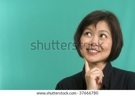 Attractive woman looking up and thinking - stock photo