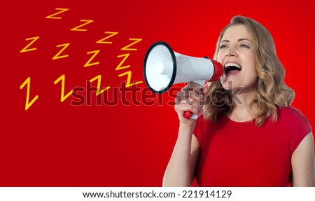 Attractive woman loudly speaking into a megaphone  - stock photo