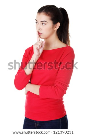 Attractive woman making a keep it quiet gesture , isolated on white - stock photo