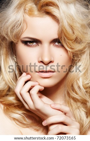 Attractive woman model with shiny blond long hair, fashion make-up and glamour jewelry - stock photo
