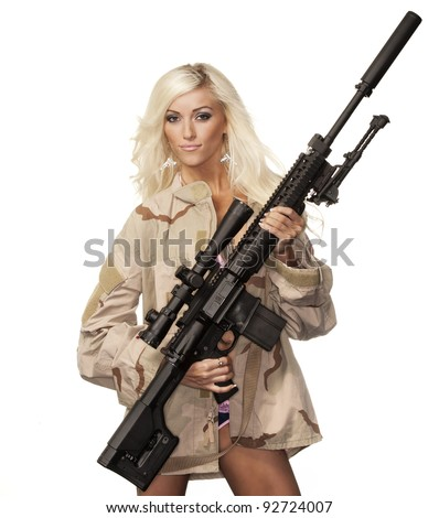 Attractive woman modelling with high power fire gun weapon - stock photo