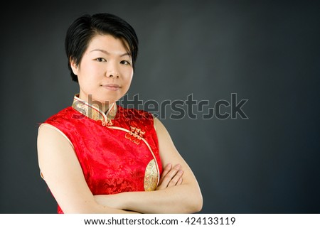 attractive woman on plain background shot in studio with soft lights with an interesting expression and dramatic lighting
