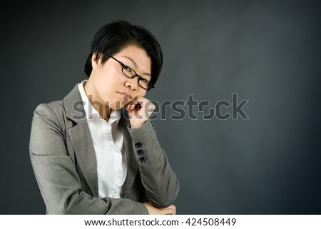 attractive woman on plein background shot in studio with soft lights with an interesting expression and dramatic lighting - stock photo