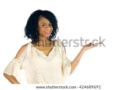 attractive woman on plein background shot in studio with soft lights with an interesting expression and dramatic lighting