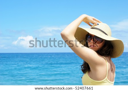 Attractive woman on the beach - stock photo