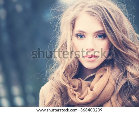 Attractive Woman Outdoors. Windy Hair, Cute Face