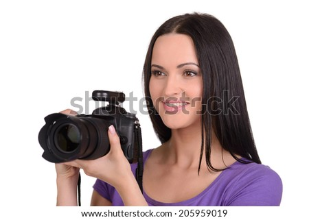 Attractive woman photographer at work in his studio