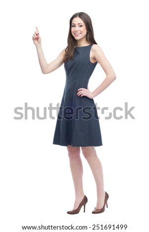 Attractive woman pointing - stock photo