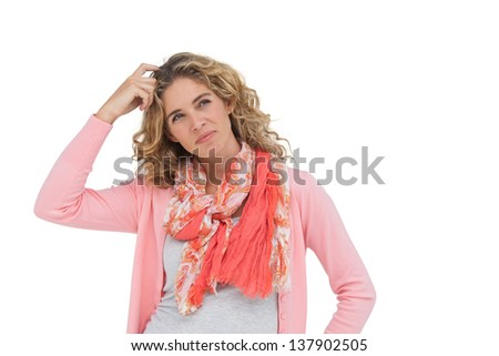 Attractive woman posing and smiling while scratching her head on white background - stock photo