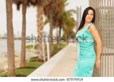Attractive woman posing in a park setting