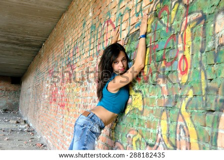 Attractive woman posing in old ruined factory building