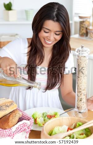 Attractive woman prepare a salad in the kitchen - stock photo