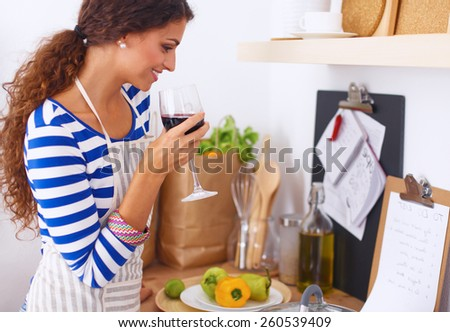 Attractive woman preparing food in the kitchen - stock photo