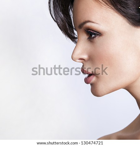 attractive woman profile isolated on white - stock photo