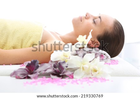 Attractive woman resting in a massage parlor.Woman relaxes in a beauty salon. - stock photo