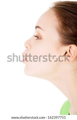 Attractive woman's profile. Closeup. Isolated on white.  - stock photo