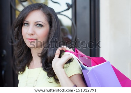 Attractive woman shopping holding colorful bags