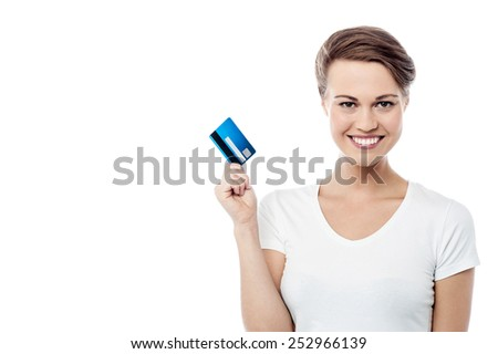 Attractive woman showing her credit card - stock photo