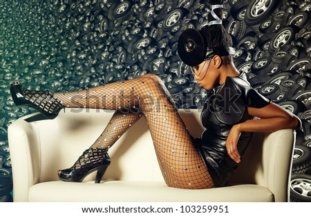 Attractive woman siting in white chair on wheels background