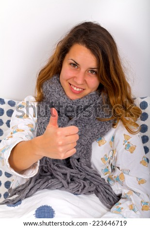 Attractive woman sitting in her bed - stock photo
