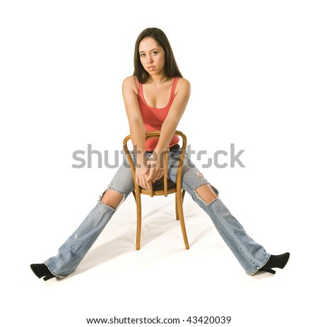 Attractive woman sitting in studio - stock photo