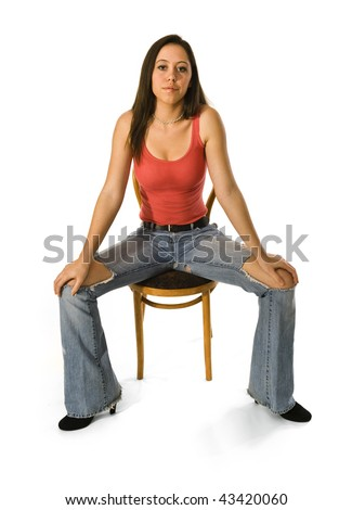 Attractive woman sitting in studio