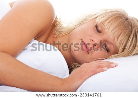 Attractive woman sleeping in bed. - stock photo