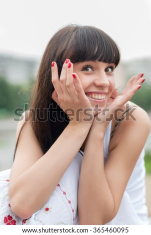 Attractive woman smiling with perfect smile and white teeth in a park and looking at camera - stock photo