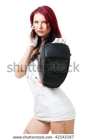 Attractive woman stand and hold welding mask in dirty shirt
