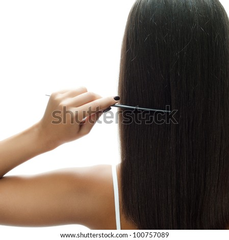 attractive woman standing back long hair brunette with comb - stock photo