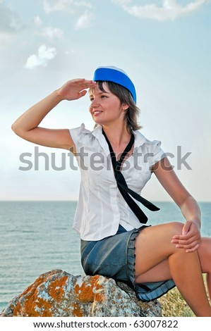attractive woman stewardess looks into the distance - stock photo