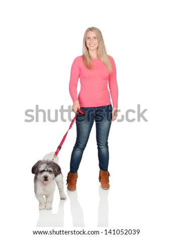 Attractive woman sticking out walking his dog isolated on white background - stock photo