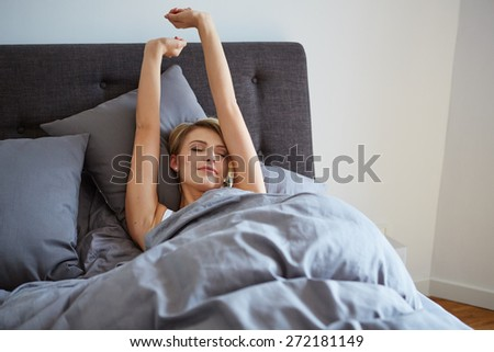 attractive woman stretching in the morning and is smiling - stock photo