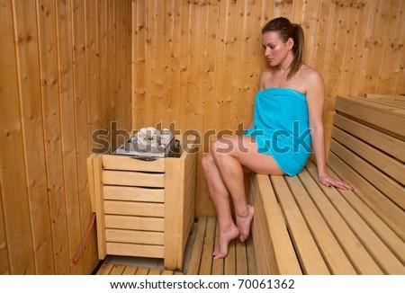 attractive woman sweating in sauna - stock photo