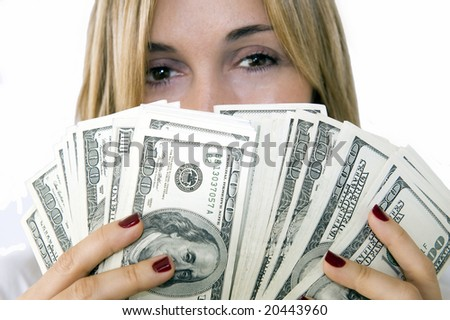 Attractive woman takes lot of 100 dollar banknotes. Focus on money.