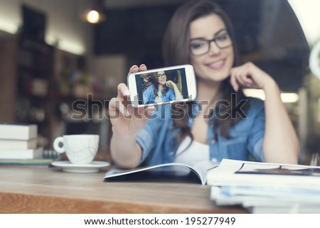 Attractive woman taking self portrait by mobile phone  - stock photo