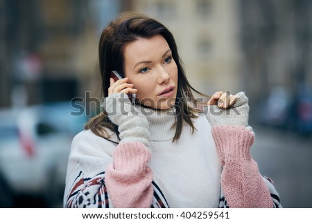 Attractive woman talking over her mobile phone - stock photo