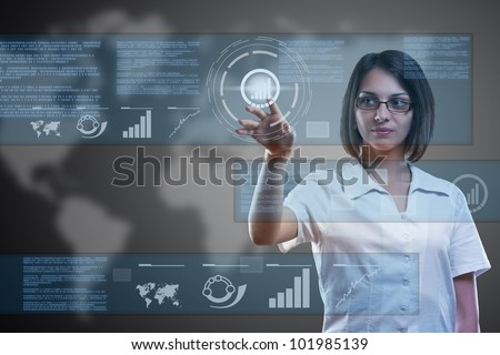 Attractive woman using technologies of the future - stock photo
