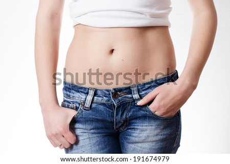 Attractive woman waist in jeans.